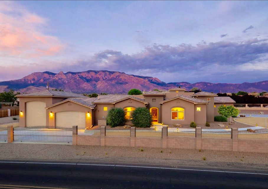 Beautifully designed custom home nestled in the highly desirable NAA neighborhood.  Exquisite craftsmanship abound in this gated .76 single level dream home with separate casita(528sq ft) and oversized epoxy floor fun garage!  Enter this gorgeous home through the private courtyard complete with outdoor kitchen, custom fire-pit, wall tv and hot tub. This open floor plan is perfect for entertaining! The chefs kitchen includes slab granite, professional grade wolf appliances, alder wood cabinets, a massive island with seating which is open to the large living room and wet-bar. The master suite is luxurious and offers kiva fireplace, elegant master bath with dual entrance to the spa-like steam shower.  His/ Her walk-in closets and jetted tub and attached exercise room.  A Must see!