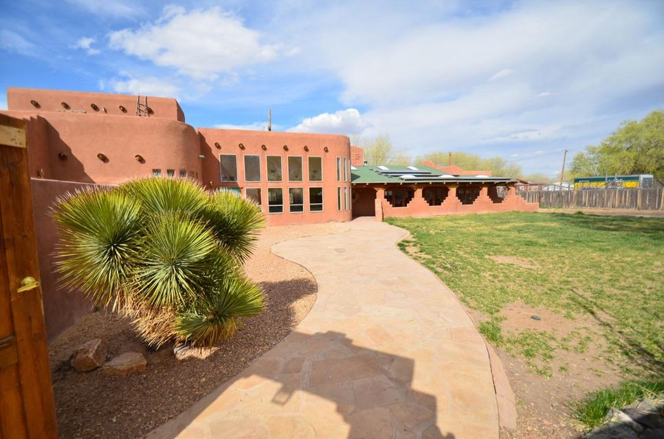 Brand New Metal and TPO Roof! New window glass! New Front Gates. Beautiful property in Bernalillo, on a quiet cul-de-sac street. 10 mn drive into Albuquerque, 30 mn drive to Santa Fe. This is a huge house, nearly 6,000 sqft situated on 2/3 of an acre. Walled yard for ideal privacy, this property has everything you need, Southwestern feel, minutes away from hiking/walking trails along the river. This property even allows for horses. The house itself, is a combination of two homes in one, the original part (2,000 sqft) features 2-3 bedrooms + 2 baths, ideal for visitors or long stay relatives :) The rest of the house is the most recent, which expansive ceilings, huge living area kitchen, great for entertaining large groups. Solar system was removed when new roof was installed (Negotiable).