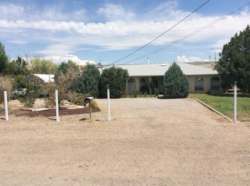 Unique North Valley property. 2672sf single family home. Located just west of the El Pueblo Rail Runner, Open living/ dining/ kitchen area, 2 Large bedrooms and 15x21 Master bedroom and 12x20 Master bath with two walk in closets. All built around a central courtyard. Enjoy the comfort of radiant heat and the convenience of the central vacuum system.* New Roof 1 year old * 14x18 Workshop with an overhead door. * Great location with easy access to Paseo Del Norte at