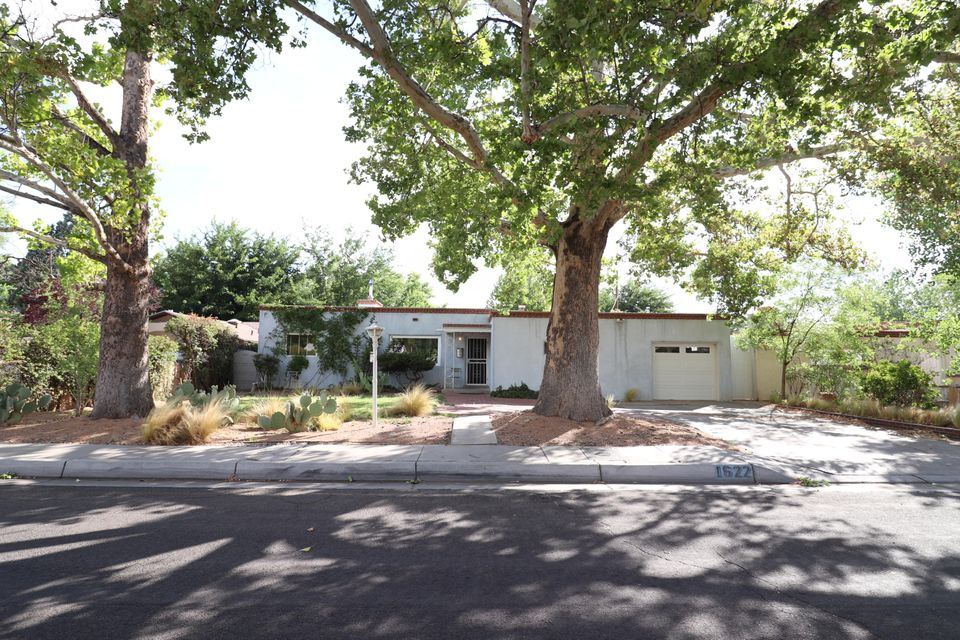 1950's Territorial w/personality in Huning Castle. Lots of natural light. Wall of glass & new Pella doors open to shaded courtyard & private backyd. Orchard of cherries, peaches, apples, and pears. New windows throughout. Newer stucco. Well-lit kitchen w/maple cabinets. Original/period bathroom tiles, fixtures & heat-retaining cast-iron tubs. Cove ceilings. Custom built-ins. Mastercool AC.