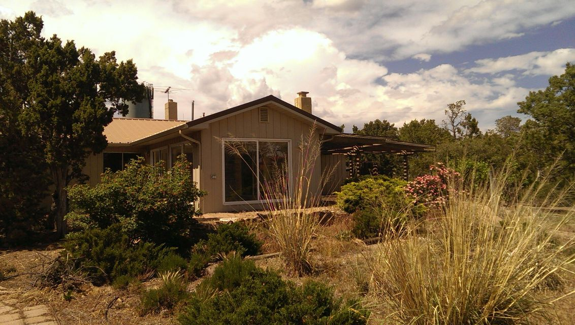 Desirable Sierra Vista Sub.Single story, 2 bedroom , 2 bath, large sunroom, 2 car garage, wooded lot with great views from back yard. Paved access all the way. Great water system.
