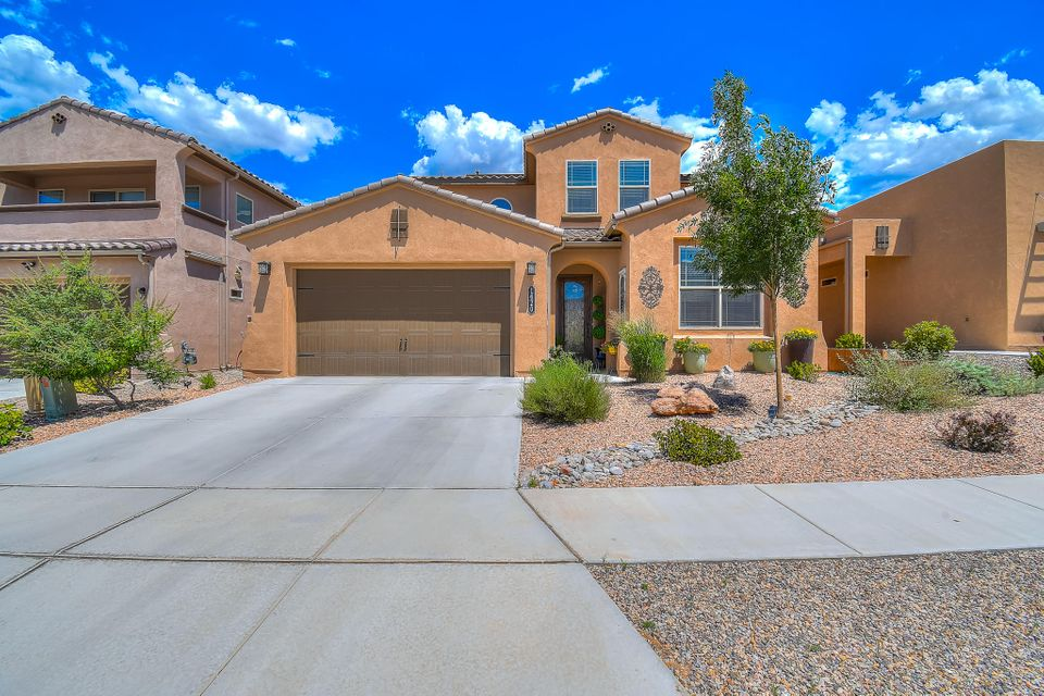 Welcome home to Voleterra Hills! Immaculate DR Horton Thomason floor plan with 50k in renovations and $71,000 in featuresv to include $30,000  owned solar, average $8 in electric bill! The fully landscaped backyard boasts a new swim spa (still under warranty), koi pond and backs to open space! Built in 2014 and still under warranty, this flexible floor plan has it all: 2 living areas, soaring ceilings, formal dining room, gourmet kitchen and main floor master suite. 2 story fireplace with stone wall. Granite kitchen with 5 burner stove. Master bathroom was just redone with quartz counters and huge walk-in shower. Upstairs there are 3 bedrooms around an airy loft. Theater quality media room . Green construction (Certified NM Silver Green Build) This home is turn key and pre-inspected