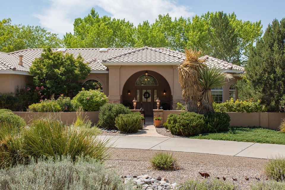 Quality Built Custom Rutledge Tuscan Style Home! On 1 Acre premium lot & one block from Bosque walking/biking trails, this Riverfronte Estates home is a MUST SEE! The inviting courtyard welcomes you into floor to ceiling elegance with both formal & informal, open & bright living spaces. The natural light, & lush garden views are abundant through every window. Featuring; coveted split master floorplan; Curved archways; Coved Raised Ceilings; Tuscan style columns; Granite Counters; Highend Appliances; Private Grand Master suite features spa like master bath w/2 HUGE walkin closets.  Backyard Access opens onto amazing lot with potential for horses, pool, casita for multi-generational living. Entire acre is beautifully landscaped with low maintenance landscaping +3 outdoor living spaces
