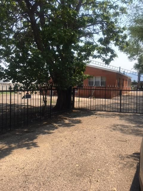This property has lots of potential as either residential or commercial or both! There is also a 2 bedroom apartment attached to the main home, included in sq. ft total. It is located in the North Valley with easy access to I-25 and shopping. Come bring your own creative ideas and make this property your own!Also listed as commercial property for sale MLS#926165
