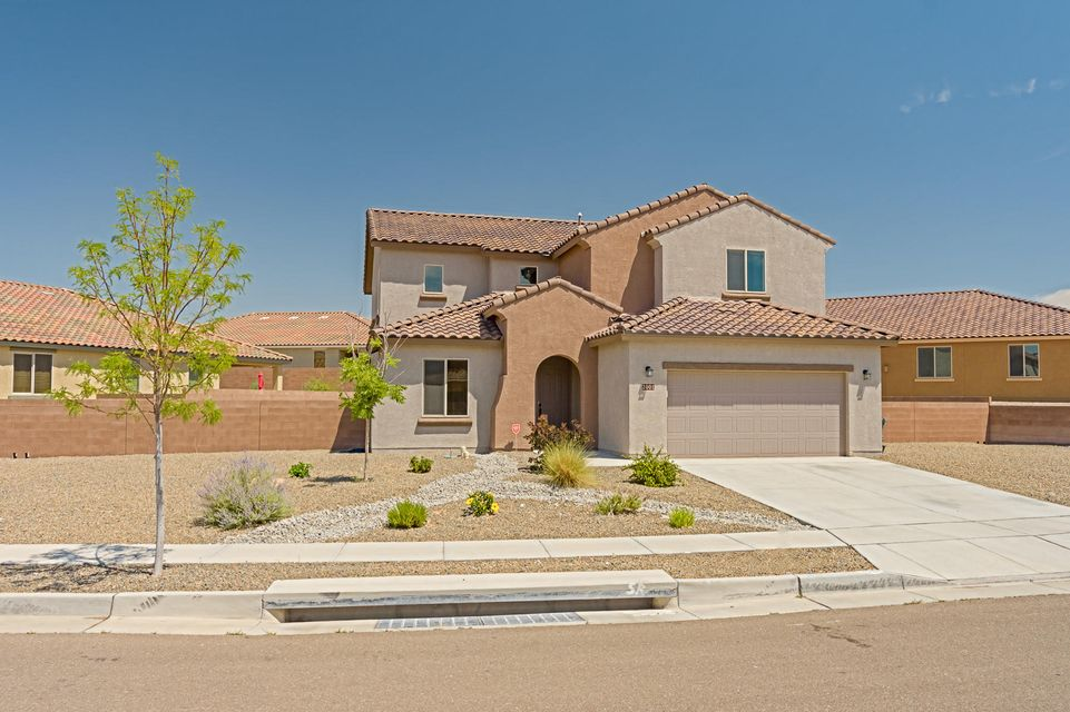 Elegant and dramatic home in Mirehaven! Soaring ceilings with TONS of windows! Gourmet kitchen with dark cabinets, granite countertops, subway backsplash & built in stainless steel appliances. Huge island perfect for entertaining! Functional open concept floor plan with guest room, office & master downstairs. Beautiful rod iron spindle stair rail lead you upstairs to a generous sized loft & 3 bedrooms. *Oversized lot with extended patio* Tankless hot water heater! Stunning tile roof! New School: Tres Volcanes Community School K-8th.  Community offers tons of fun neighborhood activities such as fall festival, easter egg huts, ext.