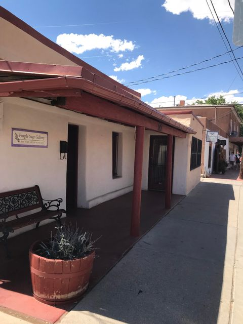 This property is located in Historic Old Town. A free standing Building on a main corner of the main block in Old Town. It has alley access and a private front porch, a side yard and a backyard with 2-4  private parking and  a courtyard. Prime Old Town location, outdoor patio and a parking lot. Property sold ''AS IS''.