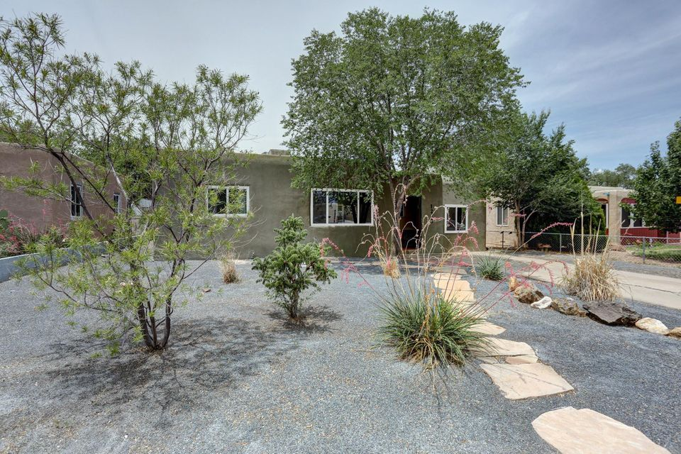 ***OWNER FINANCING*** UNM/Ridgecrest Beauty! *Convenient Location* Charm abounds with original real hardwood floors, built-in linen cabinets, wood/glass sliding doors, and warm contemporary paint colors. The spacious updated Kitchen included stainless appliances. The Remodeled Bathroom includes custom tile work in the shower & contemporary colors , NEWER VINYL WINDOWS means added security and energy savings. Beautiful newer Stucco and landscaped front yard result in great curb appeal. The huge backyard is a Must SEE with the covered patio & outdoor fireplace! Perfect for Entertaining and Relaxing! Just minutes from Nob Hill! 1 year home warranty included with full purchase price. General Home Inspection has been completed & is available upon request