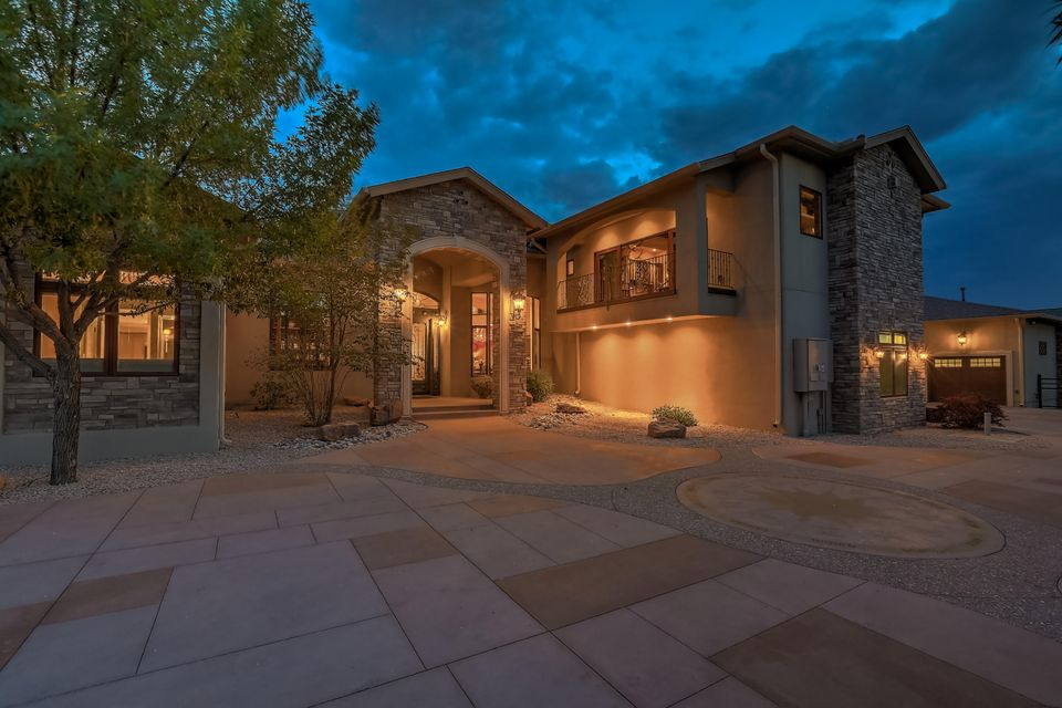 Exquisite attention to detail in every aspect of this spectacular one of a kind luxury estate on over 2 private acres.Custom wrought iron doors greet you to 3 bedrooms plus study with closet could be 4th BR, 4 living spaces. Top of the line kitchen boasting Santa Fe Custom Works cabinetry, Servo drawers, Advantium micro/convection/pizza oven, warming drawer, 6 burner gas cooktop plus griddle and pot filler at range, lighted shelves and under counter lighted cabinets.Enormous owner's suite on the main level features his and hers closets one is over 24' in length with built-in cabinetry w/ Swarovski crystal adorned pulls, dual sinks plus vanity area, oversized custom tub, amazing shower.7 car heated garage plus RV garage, glow in the dark driveway and motor court. Rec room 24x28, Loft 25x14.
