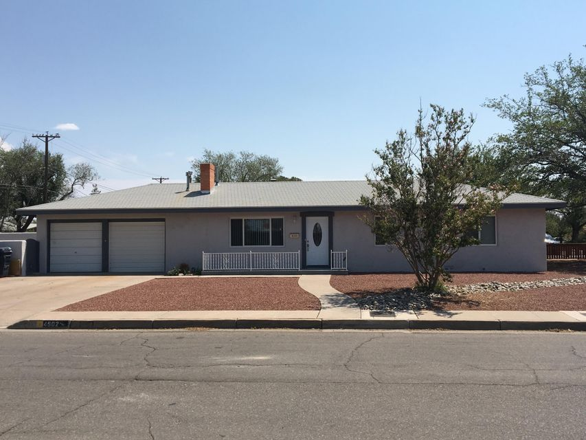 Lives larger than it's square footage!  3/br, 1/ba, 2 car garage.  Large corner lot with backyard access.  Beautifully refinished hardwood floors, updated kitchen and bath.  Refrigerated air AND a new roof just installed!!