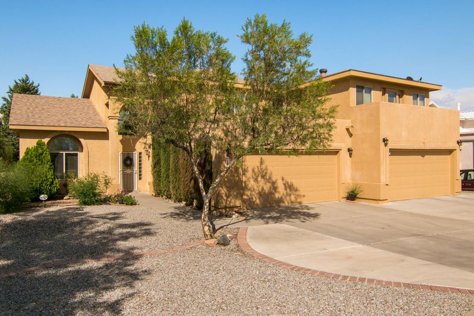 Very Rare Find! 4 car garage w/ refrig air & an apartment/in-law quarters. Move In Ready!  No HOA, views to the Sandia's & petroglyphs, Updated kitchen w/ new appliances, GE Slate Refrigerator, Dishwasher, 6 Burner Range, & Microwave. Granite counters, stainless steel sink, pantry & breakfast nook. Soaring ceilings & cozy fireplace, Large .31 ac lot w/ back yard access poss, 17X15 covered patio & open patio as well. Storage shed stays & play ground if needed. Updated windows thru out, Hunter Ceiling fans, Smart home wiring package, USB outlets, motion lights in garage, pre wired for Festive Lighting, Water heater w/recirc pump, thermostat is programmable & includes an app for your phone. Master suite is deluxe w/ new shower, walkin closet, double sinks & filtered water at sink. **See More-
