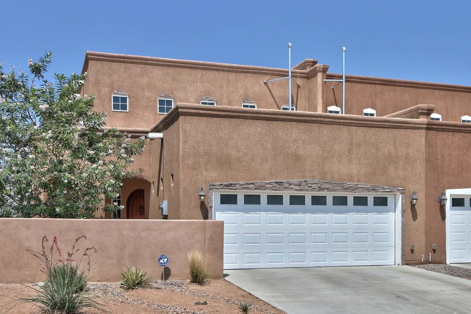 *OPEN HOUSE-Saturday 9/15 12:00-3:00 pm* North Valley 2 story Town-home built in 2009. The home has been beautifully maintained. High ceilings, open floor plan, granite counter tops in kitchen and all bathrooms. Kitchen features stainless steel appliances with plenty of counter space, lots of cabinets and a nice size pantry. Master bedroom suite has a private balcony. Master bathroom shows beautiful with separated double vanities and two large finished walk in closets. Great location to shopping, freeway access, downtown. Easy access to walking, biking and the bosque trails. Ready to move in!