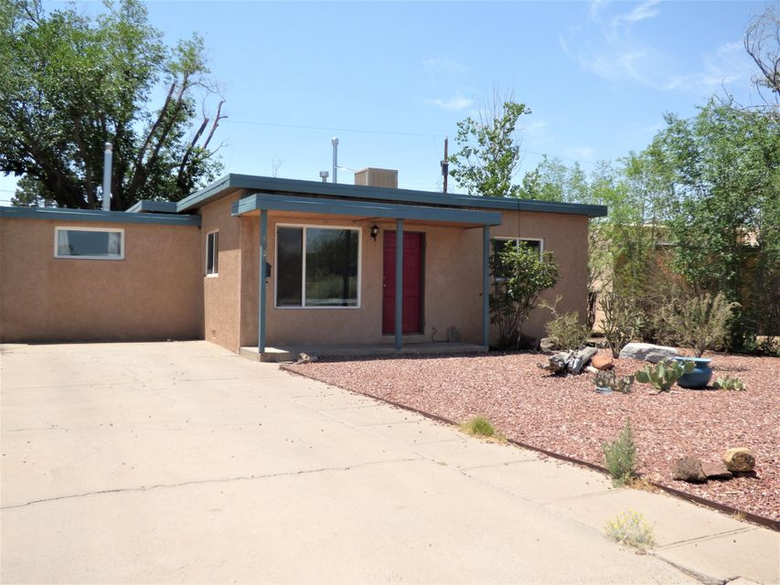 Fantastic Location Near UNM and Nob Hill. Charming Home with it's Gleaming Hardwood Floors in the Living Room and Both Bedrooms. The large Kitchen Offer Tons of Cabinets and Counter Space, All Appliances Including Fridge and Brick Flooring. There's a nice sized Dining Room as Well. You'll Find a Huge Family Room with Wood Burning Fireplace and Tile Flooring that Could be a 3rd Bedroom, Office or Game Room. Step Out to a Nice Sun room that Overlooks the Backyard. Newer Double Pane Windows, Kitchen and Bath Updated in the last 10 yrs or so and Easy Maintenance Yards.