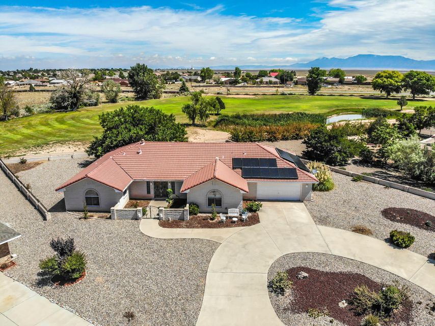 This custom built home sits on 1/2 acre on the 14th hole at Tierra Del Sol Golf Course. 3010 Square feet, 3/4 large bedrooms, 3 baths, 2 living areas, walk in closet in master bedroom, main living area flooring has been upgraded, master bathroom has updated walk in shower, Open kitchen has updated stove  with lots of cabinet space, Plenty of closet and storage space, 2 car over sized garage. Easy maintenance outside, circular drive way located in a quiet cul de sac. This an exceptional value at $79.00 per square foot.