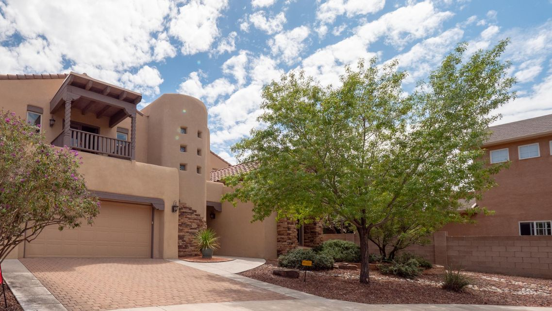 Custom home located only 2 blocks from La Cueva High School. Home offers four bedrooms with a huge master suite, walk-in closet with built-in shelving, full bathroom, double vanities, separate shower and jetted tub. Two additional bedrooms, jack & jill bathroom, laundry room, study and loft areas on upper level. Second master on mail level with 3/4 bathroom and walk-on closet. Three car garage is tandem on one side with huge storage closet. Newly painted throughout, new water heater, and four new low flow ADA toilets. Low maintenance yards with automatic drip systems and open/covered patio combination. Refrigerated A/C and cul-de-sac living!