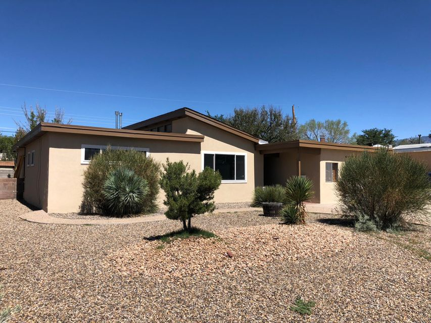 Beautiful, remodeled 3 bedroom, 2 bathroom home. NEW stucco, floors, appliances, and water heater. Open floorpan with a fireplace, heated sunroom, and service room!