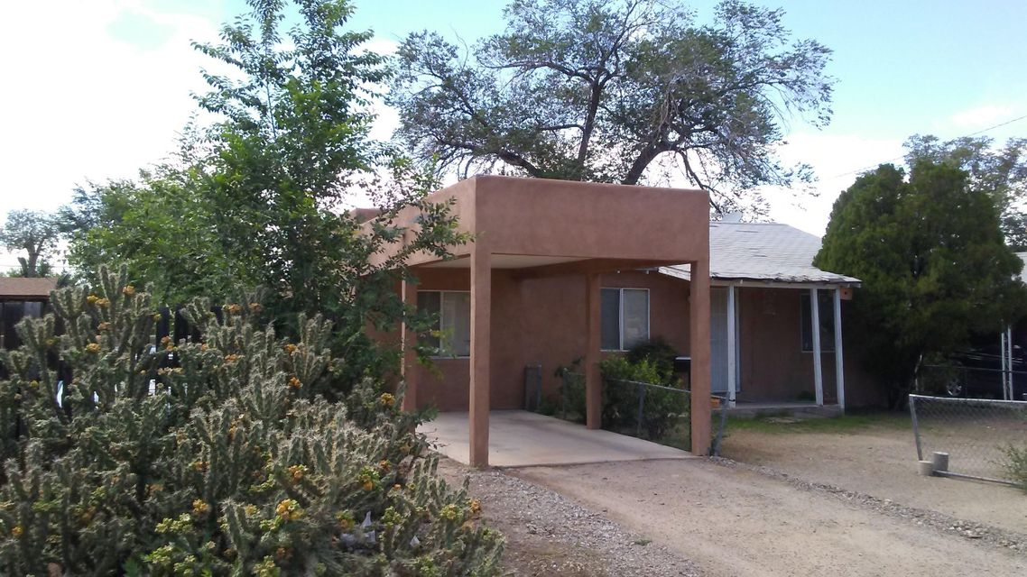 Wonderful starter home or investment property!    Quiet street, close to to Uptown, UNM, and Kirtland Air Force Base.  Adorable 2 or 3 bedrooms, 2 living spaces, and refrigerated air! Ready to show and ready for move-in!