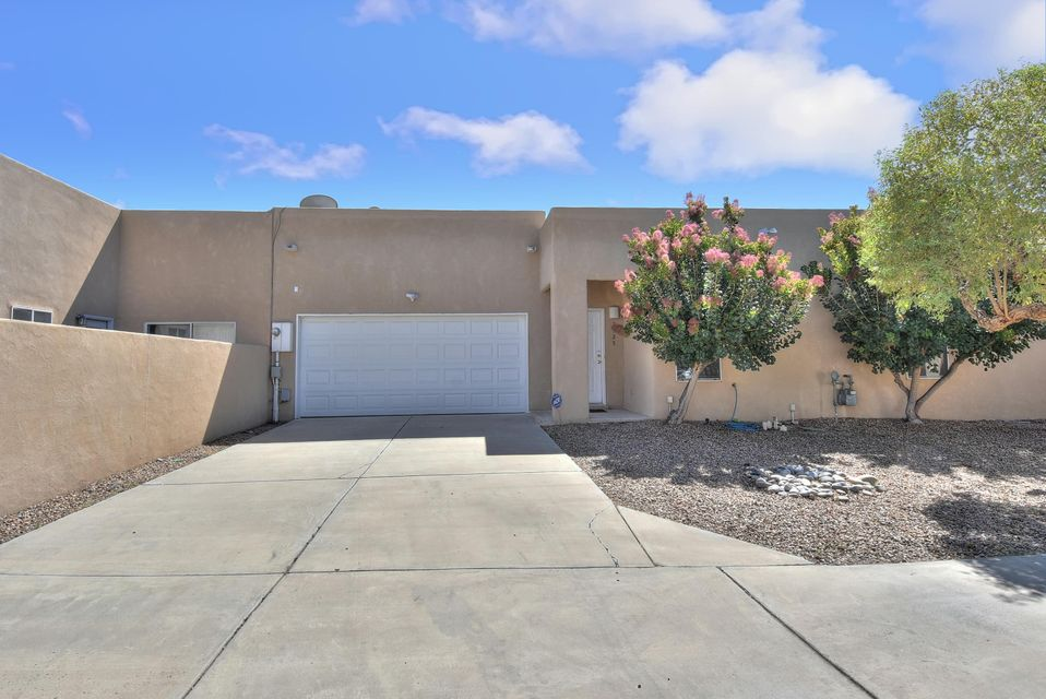 This 2bd/2bth townhouse is tucked away in a quiet little cul-d-sac, in the very desirable NV area. This home features an open floor plan with tile throughout main rooms and carpet in bdrms. Enjoy the gas fireplace in the LR on those cold winter nights. Nicho and ledge in foyer to display your treasures.  Each bedroom has its own full bathroom. Front and back yard fully landscaped with auto sprinkler. 2 car garage with opener. Washer, dryer and refrigerator stay. Walking distance to Los Tomases Park which boasts lots of walking and bike trails.