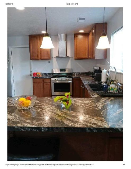 Find yourself at home with this recently remodeled NE Albuquerque home. Spacious master bedroom with separate entrance to  big backyard with covered patio, 220 outlet wired for a hot tub. Updated windows,flooring and stainless steal appliances. Totally finished/insulated 2 car garage with storage above. Don't miss out on the gem!