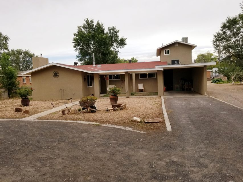 This is a must come and see this great looking home in the beautiful South Valley. This home sits on .53 acres of land. Three horse stalls and back yard access for all your trailers and toys. Plusa 560 sq. ft. In-Law-Quarters/Guest House. (not included in sq ft). The in-law-quarters/guest house available to view contingent on acceptable offer. There are many  upgrades i.e.: granite counter tops, stainless steel appliances. Low-e, double pane windows, electric and plumbing fixtures.This beautiful home is located in a Cul De Sac and won't last long.