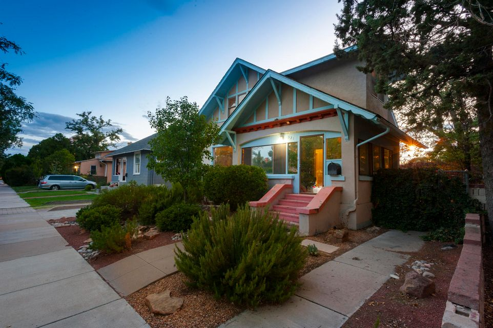 This Art & Craft Bungalow in Historic Downtown Albuquerque has it all. This 5 BDR 2 full bath home offers an open floor plan down stairs.  From the enclosed sunroom that captures the morning sunlight, to the dinning room that features a traditional built in buffet.  The dinning room flows into the spacious living room that has 1 of 2 fireplaces this home provides.  The kitchen attaches to the rear service room that leads to a spacious basement that offers it's owner plenty of possibilities.  Upstairs you will find 3 BDRs with vaulted ceiling and built-ins throughout that provide lots of storage space.  The larger bedroom has it's own wood burning fireplace and study.  Vintage moldings run throughout the home.  Come see the possibilities of downtown living.