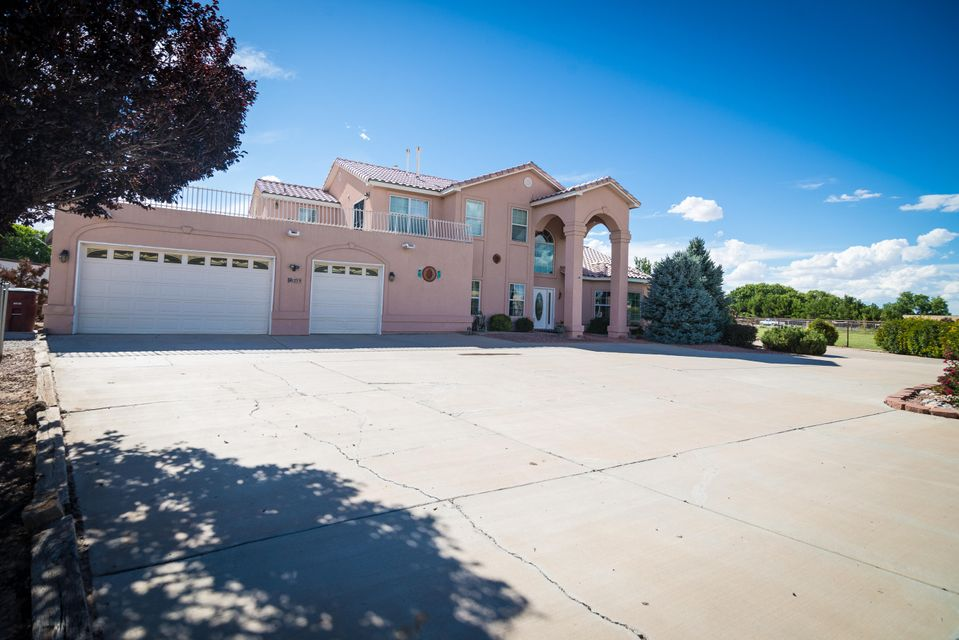 Fabulous property on 2.0 irrigated acres, w/fruit trees, pasture, garden area in a secluded neighborhood. Custom home with great room, custom wet bar, kiva fireplace, and built-in lit wall display. Formal dining, gourmet kitchen new SS appliances, Corian counters, pantries, island and lots of cabinets. Features include lit nichos, marble window sills and custom lighting. Breathtaking staircase leads to oversized Master Suite w/two-way FP, office/sitting area leading to deck w/mountain views. Two more bdrms upstairs w/Jack and Jill bathroom and a 4th bedroom downstairs w/access to handicap bathroom for mother-in-law. 3 car garage w/workshop, 4 outbuildings for storage or animals and detached 30'x60' insulated garage, all w/electricity, perfect for vehicles, equipment, RV or workshop.