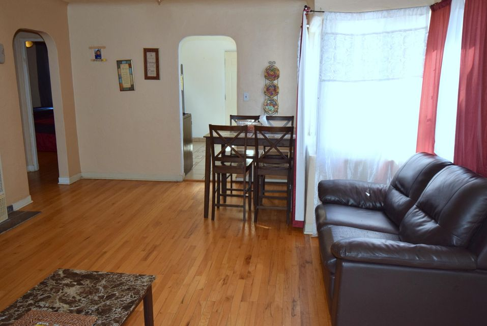 This lovely home features 2 bedrooms, 2 baths with possible 3rd bedroom (has laundry area inside). Storage room in backyard.