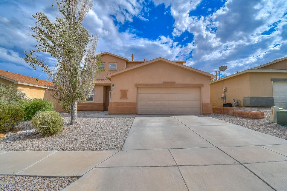 Open, spacious, and bright home in great NW Albuquerque community!! Soaring 9ft ceilings throughout. Large living area, with gas fireplace for a warm ambiance, is open to the dining and kitchen areas. Master bedroom and bathroom on the main level with double sinks, relaxing garden tub, and large walk in closet. Upstairs enjoy a 2nd large living area, 3 huge bedrooms all with WICs, and full bathroom. Blank canvas backyard for your dream landscaping. Lovely walking trails just behind the property. No back yard neighbors! Come check out this beautiful home before it's gone!!