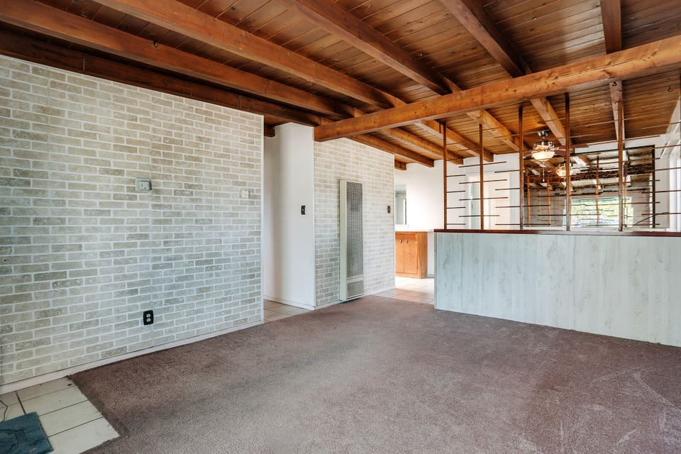 Great starter home or Air BnB. Only two owners since 1955, Check out the ceilings Amazing. This 3bedroom 1 bath 1 over sized garage on a cul-de-sac offers convenient location with easy access to everything.  All Appliances stay.