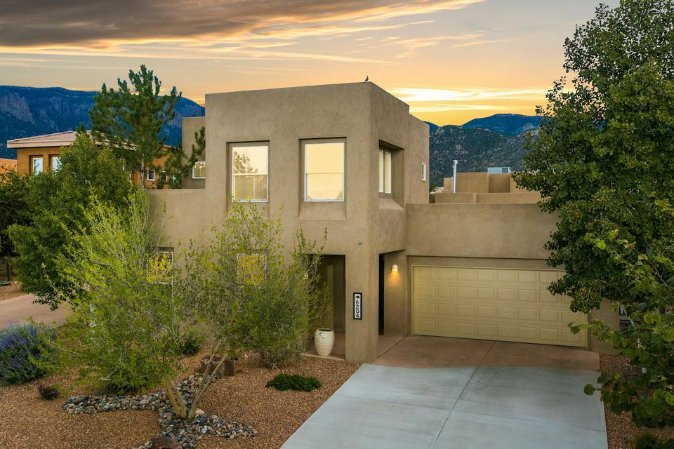 Located in a gated community in one of the most desirable neighborhoods in the Northeast Heights, this wonderful home has fabulous updates throughout.   This distinctive floor plan has a one story main house with a detached two story casita and a two car and a one car that gives lots of flexibility for living. A wonderful location with a community swimming pool and close to miles of stunning hiking and bike trails, this community has something for everyone.   A spacious yard with covered porch and mountain views for year round outdoor living.  This home boasts a tastefully updated chef's kitchen with high end stainless appliances plus a brand new 6 burner cooktop, wood beam ceilings in the living room, new roof with transferrable warranty, new stucco, refrigerated air. The list goes on!!