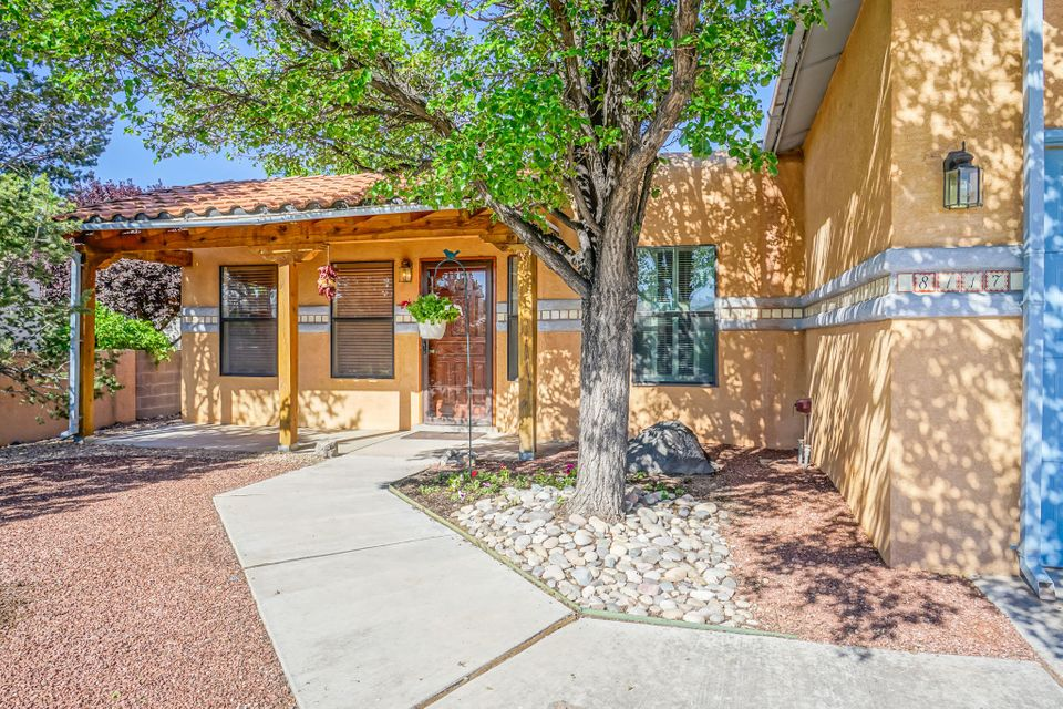 Welcome to this WELL Maintained, Updated MOVE in ready home! You will be smiling as you drive up. This Single story 3 BEDROOM home offers a nice entry & Formal DINNING with lots of natural light (or 2nd living area?) GREAT room with Vaulted beam ceilings. Beautiful Woods Flooring! Lg Open kitchen with stunning granite counters & bar top. Plenty of Cabinets & Storage, Walk in pantry, Skylight, Custom gas FP. LARGE Master sits towards back of home w/dbl closets, dbl sinks, separate shower & IN GROUND CUSTOM TUB. Sun room w/Hot tub! Other two bedrooms are nice sized. Lg lot & LANDSCAPED front & back & backs to PETROGLYPH NATIONAL open space . Backyard Access for additional parking. Garage finished with workshop area, sink, 220 amp service & attic pull down steps. Honestly, This is a Good one!