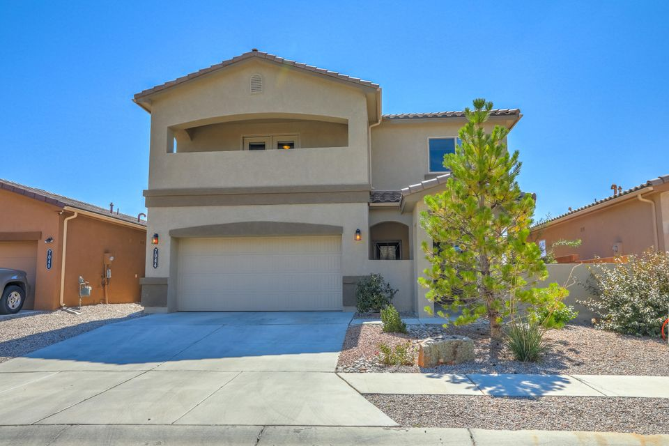 Fabulous Roark floor plan in VVHS District offers 4 bedrooms, an office, dining/game room, and loft space!  The main living area and kitchen offer the grand living space that make it perfect for relaxing and entertaining.  The generous size loft is ideal for a second living/flex space.  Retreat in the large Master bedroom that has a private balcony with lovely views of the Sandia's.  Master shower and closet are oversized!  The spacious back yard is fully landscaped and has plenty of room for outdoor entertaining.Schools and Neighborhood park are a short walk away! Refrigerator conveys with acceptable offer. Wall Mount TV does not convey.Make this Green Built DR Horton, Roark plan your very own!  Available for daily showings, Call a Realtor Today for your personal tour!
