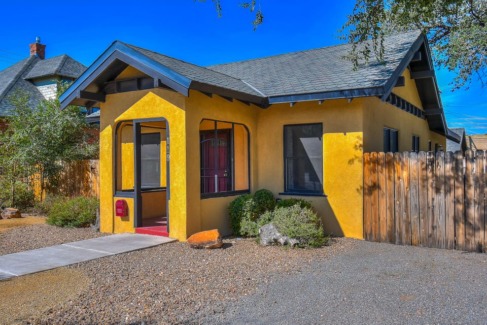 Welcome home to the Huning Highlands Historic District! Completely updated and remodeled from the studs up! Off-Street Parking with Potential back-yard access for a secured parking area! Beautiful vaulted Beam-Ceilings in all main living areas fill with natural light. Huge Master-Suite with Private entrance off the South Patio Garden. Office/Den room with Double French doors, Oversized Walk-in Pantry and Wet-Bar make for easy entertaining! Updates include Plumbing, Electrical, Pella windows, Central Heating and Refrigerated AC, Updated bathrooms with Travertine-tiled surrounds, Jetted Master Tub, Hickory Cabinets with Stainless Steel Appliances, and Much More!Near EDO, Downtown, UNM, Hospitals, Dining and entertainment!! **Special Financing Available** Saves THOUSANDS!!