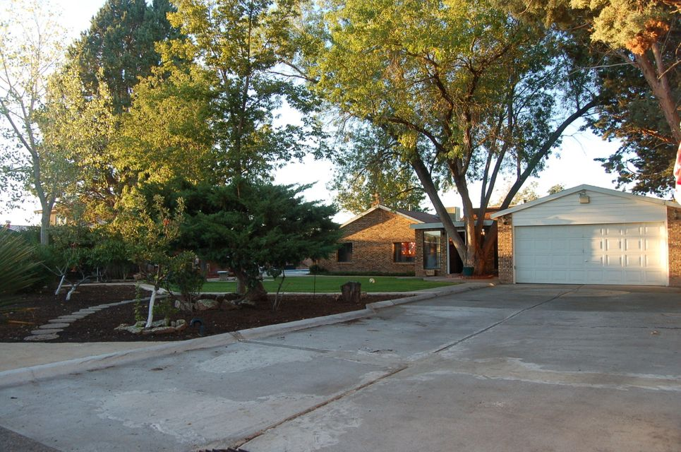 Beautiful North Valley 1/3+ Acre Fully Landscaped, 2543 Main House, Guest Or Pool House With Mini Kitchen & Full Bath(Not Part Of Main House S/F), In-ground Pool With Automatic Cover, Hot tub, Brick BBQ, Concrete Patio, Trees, Grass, Fully Fenced/Walled With Auto Privacy Gate, Exposed Interior Adobe, Wood Walls/Ceilings/Beams, Almost New Appliances, Hardwood Floors, 3 Clearstory Windows & Plant Area Inside, Unique Park Like Yard And Concrete Patio, Has Been A Vacation Rental Since 2007, Currently Occupied By Family Member Until It Sells.