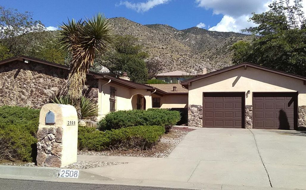 Great home near the foothills. Neat clean and ready for quick close and occupancy. New roof and flooring and lots of extras in this spacious home in mature neighborhood on quiet cul de sac just minutes from Piedra Lisa and Whitewash trail-heads. Large vaulted family room with gas log FP. Eat in nook and formal Dining Room. 2nd Large Living Room. Additional large gym/playroom/office or could be additional master suite with glass block natural lighting, exhaust venting fan, 220v wired for hot tub or could be ideal for indoor lap pool! Large master BR with Walk in closets throughout. Big galley style kitchen with dbl ovens, cooktop and micro. Quality wood cabinetry. Pantry and laundry service rooms. Refrigerated air, Garage with tons of storage and 220v. Covered patio, fountains pond