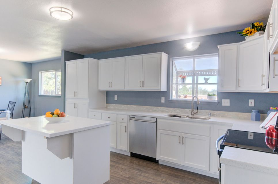 Remodeled and Stunning 5 Bedroom Split-Level Home on a Spacious .31 acre Corner lot in Paradise Hills is now available!!   Featuring Fresh Paint, New Flooring, New Stainless Appliances, Light Fixtures, White Cabinets with soft close feature, New Kitchen Island/Bar, Solid Surface Countertops and New Vinyl Windows.  3 separate heating and cooling systems for each level of the house for improved efficiency and comfort. Dazzling Kitchen opens to split living/dining room for that open floor plan feel.  2nd Living Room offers a Cozy Fireplace, Wet Bar & Game Room area, which is great for entertaining your crazy friends & family:) With remarkable curb appeal, updated features, spacious backyard with covered patio and a circular driveway..this is the one to check out.