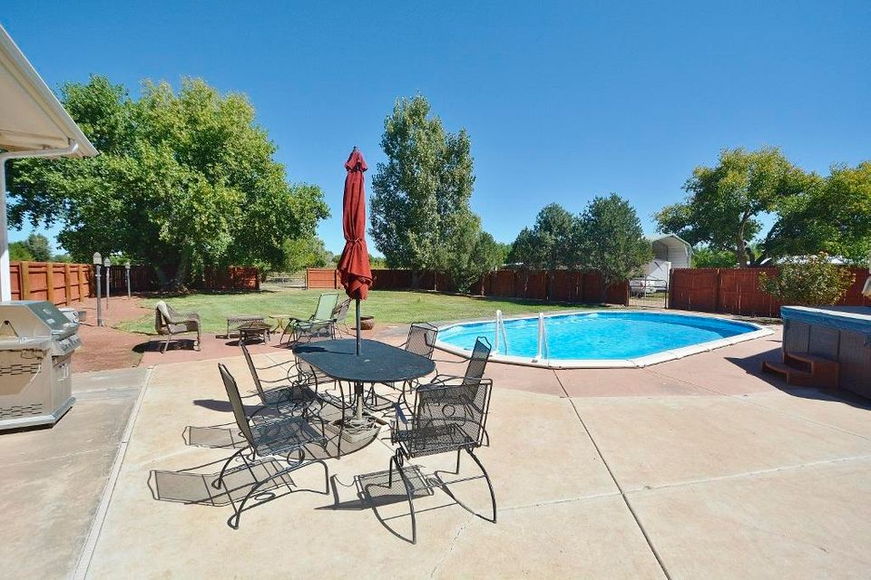 Country Living on 4 ACRES!! 2 acres of irrigated pasture!   Private courtyard, electronic gate!  Casual elegance abounds in this custom home featuring 4BDRs/4BATHs/3CG with two living areas, formal dining, flex room/man cave! Enjoy the incredibly beautiful backyard & grounds with outdoor pool & hot tub, covered & open patios, with lush grass, trees & shrubs making it the ideal location to entertain family & friends!  Custom kitchen features a double oven, gas cooktop, custom cabinetry, butler pantry & walk-in pantry, an entertainer's island; perfect for family gatherings & multiple cooks!   Private master suite features an oversized shower, his/her vanities, two walk-closets, access to the outdoor patio & pool.  Large secondary bdrs with Jack N Jill bath & walk-in closets.  Country Oasis!!
