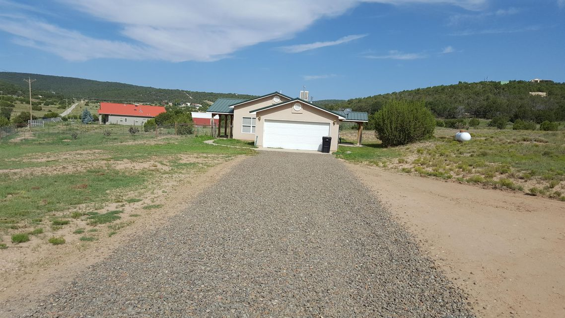 This wonderful ranch style home in Edgewood is on over 5 acres, move in ready. New applicances, tile floors, large master bdrm, Epcor metered water, metal roofWill consider REC with 20% down