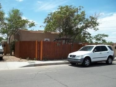 Beautiful One bedroom (possibly Two BR/or second Living area/office). Well maintained  adobe home with fenced front courtyard and large fenced lot for garden or play area. Recently Updated Electric, Thermal Windows, Appliances. Sewer lines replaced 2017. Has small enclosed and heated front patio.Great Investment opportunity - Currently rented desirable location. Huge Double Lot In Popular Downtown Area. Just 2 Blks From Zoo. Close To Tingley Park/Beach and Easy Access To Downtown Sports Facilities, and I-25.