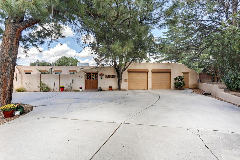 UNIQUE & COMFY! So much to love! Almost 1/2 acre in lovely Broad Acres. Most of the home recently painted! Lots of parking, 5 car gar.. over sized 2 car attached, ~1975sqft detached workshop garage w/ water, 1/2 bath, power. Plenty of room for cars, boat, RV, bikes, tools. Storage galore! BY is a creative, colorful park. Amazing covered patio, block wall, custom gate, gazebo, fire pit, built in grill. FAB mtn views nobody behind! 3bed + office/rec/bedroom. Master has large retractable skylight to star gaze, kiva fp, steam shower. Brick floors, 2 living areas, Kiva FP rock hearth w/ electric hot plate, thermal dp windows, corian counters in kit, plenty cabs & 2 skylights that crank open, sep utility room w/ pantry storage. SOLAR.. owned U get the benefits. COME EXPLORE THIS IS 1 OF A KIND