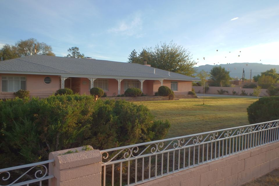 Ring ring 505 Tyler NW is calling! Yep, even the address is classic New Mexico!  Mid Century Construction by namesake builder Mr. Tyler for his own use, high end quality for the times, quality that lasts. Main house is 2590 sf 3 beds 2 baths, casita 954 sf 2 beds/1.5 baths, $158 a sf, competitive price for the Village. Many upgrades, new SS fridge & oven, new shingles, new electrical service, new water & sewer lines. Other features Plantation shutters, hardwood floors, flagstone accents, birch cabinets, large rooms.  All on lush 1.19 acres, includes adjacent .35 acre C1 Zoned lot, plenty of room for horses, vineyard, green house or other live/work business uses. Rent casita,  cover a portion of the payment! Tired of SW style on a dusty lot? Come enjoy endearing ranch in the greenbelt!