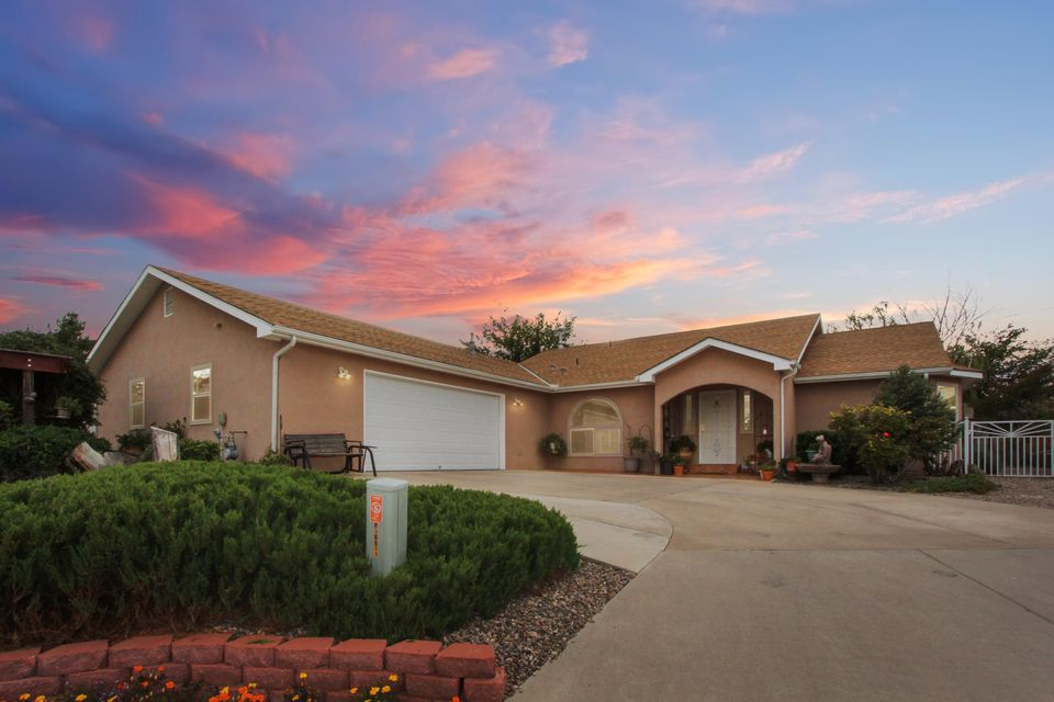Sitting on a quaint cul-de-sac and large corner lot is this beautiful home with a great open floor plan.As you approach the house, you will see the landscaped front yard w/ its own water feature where you can enjoying Captivating views of the Sandia Mountains every night! Entering the house you are welcomed with luxurious beaming wood floors that continue throughout the house. The kitchen has been updated w/ stainless steel appliances and impeccable Tile. It's easy to entertain and enjoy the gentle breeze in the gorgeous backyard. Garage is Oversized! There's backyard access and space for an RV! Intel, Cottonwood Mall, and Freeway are all within minutes drive.