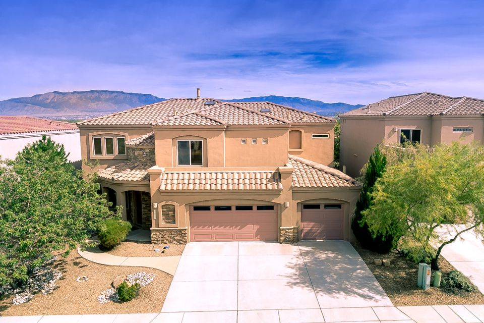 Spectacular Custom Built Charter home nestled in the highly desirable gated community of Oxbow. Come see this spacious open floor plan with 5 bedrooms, 3 bathrooms, and a 3-car garage with over 3,300 sq. feet of living space, complete with unobstructed & Stunning Views of the Sandia & Manzano Mountains in your private backyard. Prepare a gourmet meal in your high-end kitchen replete with top of the line Kitchenaid appliances, & entertain your guests in your formal dining room or on your large expansive covered patio. Soaring cathedral ceilings greet you on entering this home, and is complete with a large living and guest bedroom & bath on the ground floor.  A sweeping staircase takes you to a large loft, & then three bedrooms & your Master Bedroom with your own Private Balcony & En Suite.