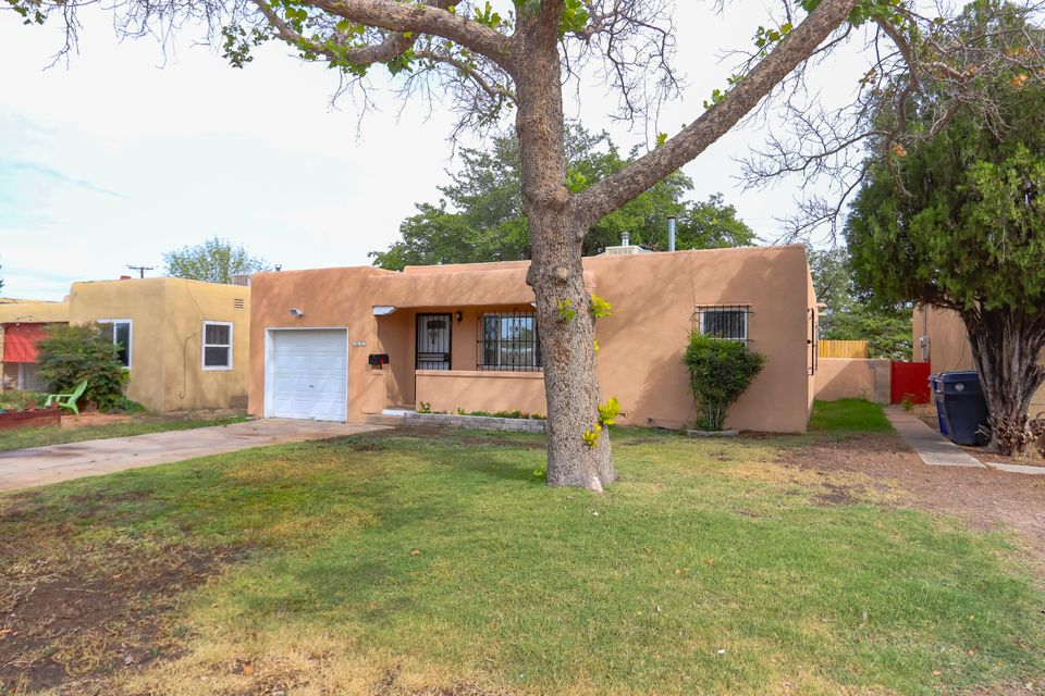 OPEN HOUSE 11/14-11/16/18 2:00-4:30. Seller will contribute $2,000 towards Appliance Package with acceptable offer. Expires Sunday 11/18/18!!!Cute, unique, and recently updated 3 bedroom home with an amazing outdoor living area. The hidden gem has a Outstanding private patio area located in the center of the home with access from the kitchen, living area, master bedroom, and to the huge backyard. It has a relaxing cascading waterfall, covered with a screen to keep out the elements. Newer windows, furnace, and hot water heater. Updated electric system, new sewer line, and new roof. Huge private backyard, with gated access for all your toys. Close to UNM, Nob Hill, entertainment, and restaurants. This home is absolutely charming from the minute you walk in.