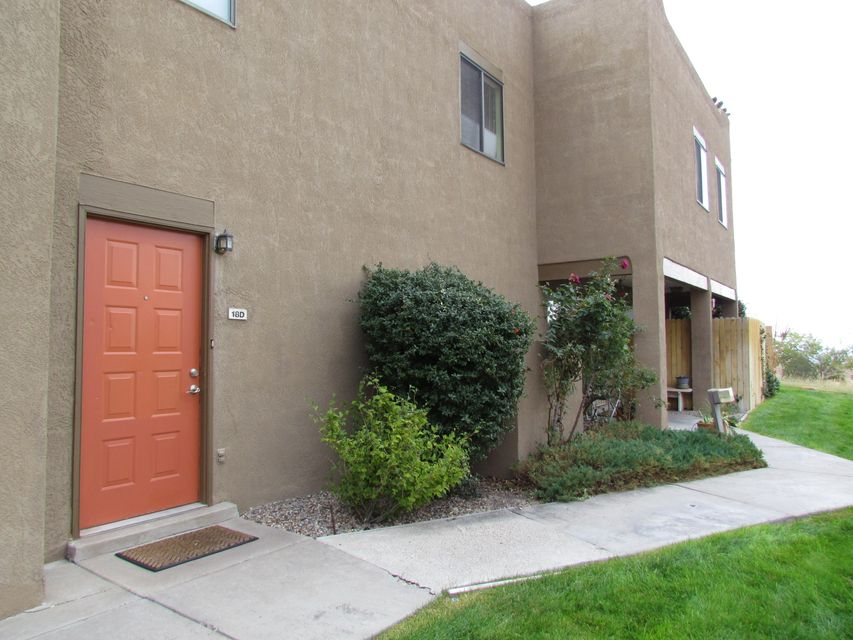 Enjoy mountain views from balcony of condo nestled in foothills.  Open floor plan with all living space located on one floor on upper level.  Features fireplace, walk-in closet and jetted tub. Kitchen has pantry and includes all appliances.  Quiet area with beautiful landscaping.  Garage has storage space and workbench.   HOA covers water, sewer and refuse.   Sold ''as is.''