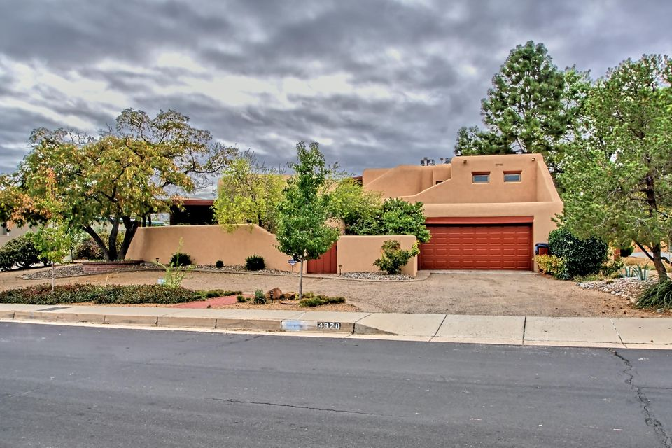 Distinctive Authentic Adobe construction nestled just steps from Altura Park in UNM area!  Wake to stunning views of Sandia's from Master suite! Over 100k in recent updates: 2017 Elastomeric exterior paint, 2015 Anderson doors/windows, 2014 membrane roof, fully remodeled Bths, Maple hardwood floors, Morso FP insert, Miele W/D, fully updated lighting, beautiful landscaping and fruit trees! Hand carved door beckons you into this spacious, bright and open home. GR has exposed adobe walls with custom FP featuring brick floors, wall of glass doors, and wood beam ceilings! DR opens to front covered patio, ideal for entertaining! Spacious kitchen features abundant cabinetry/large island/Miele DW/JennAir fridge/walk in pantry/wet bar area! Nursery/office/artist's studio off owner's suite!