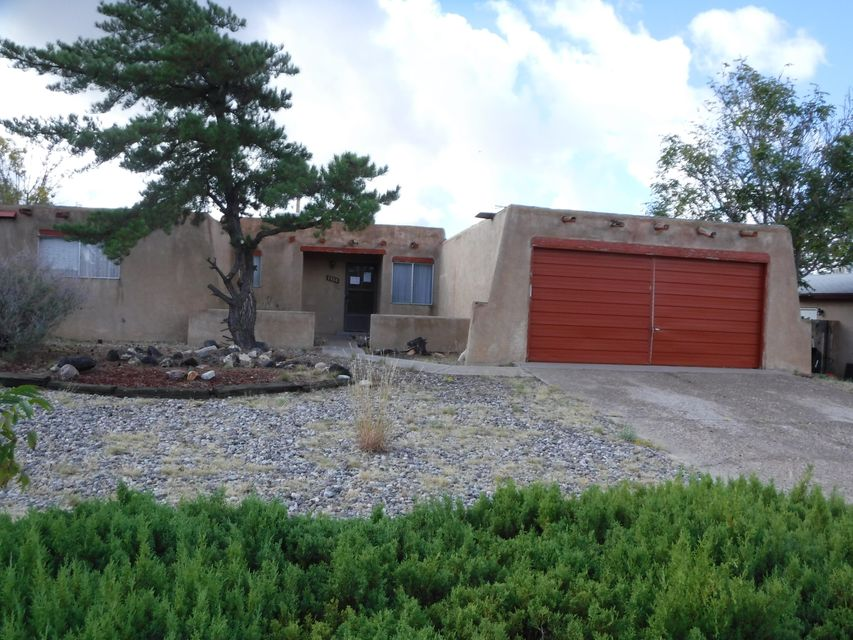 Great home located in the NE Heights Area, four bedrooms, two bathrooms, family room has fireplace, kitchen with open space and plenty of cabinet space,  large backyard with Possible backyard access, easy access to I-25 and Paseo Del Norte.