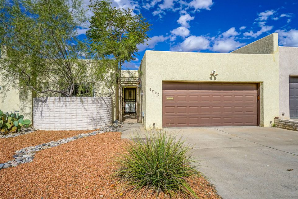Wonderfully remodeled town home in the sought after Sandia HS district! Rare opportunity. Extremely low maintenance townhome with NO HOA! Centrally located in the Uptown area of ABQ. Recent remodel includes brand new refrigerated air furnace combo unit, 100% kitchen remodel including all new appliances, new tile flooring in the kitchen, newer floors throughout the home, and bath remodel as well. The home also features atrium areas for the person with a green thumb. This is a must see home if you're looking for low maintenance with NO HOA!!!!