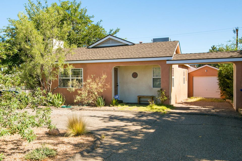 OPEN 11/18 From 1-3pm. Character & Charm abound in this classic Ridgecrest home.  Three lovely bedrooms with walk in closets and hard wood floors, two updated baths. Two living areas and updated kitchen with breakfast bar. Take in the mountain VIEWS from the Juliette balcony off the family room. Enjoy the large covered deck year round. Archways & built in storage add to the charm. Recent updates include refrigerated air/hvac, a 2016 water heater, updated windows, recent roof (2015) and new deck (2017). Plus a one car garage with storage space all on a large corner lot, with low maintenance yard.  Excellent location provides easy access to Nob Hill dining/shopping, UNM, Sunport, & UNMH! Priced to Sell!
