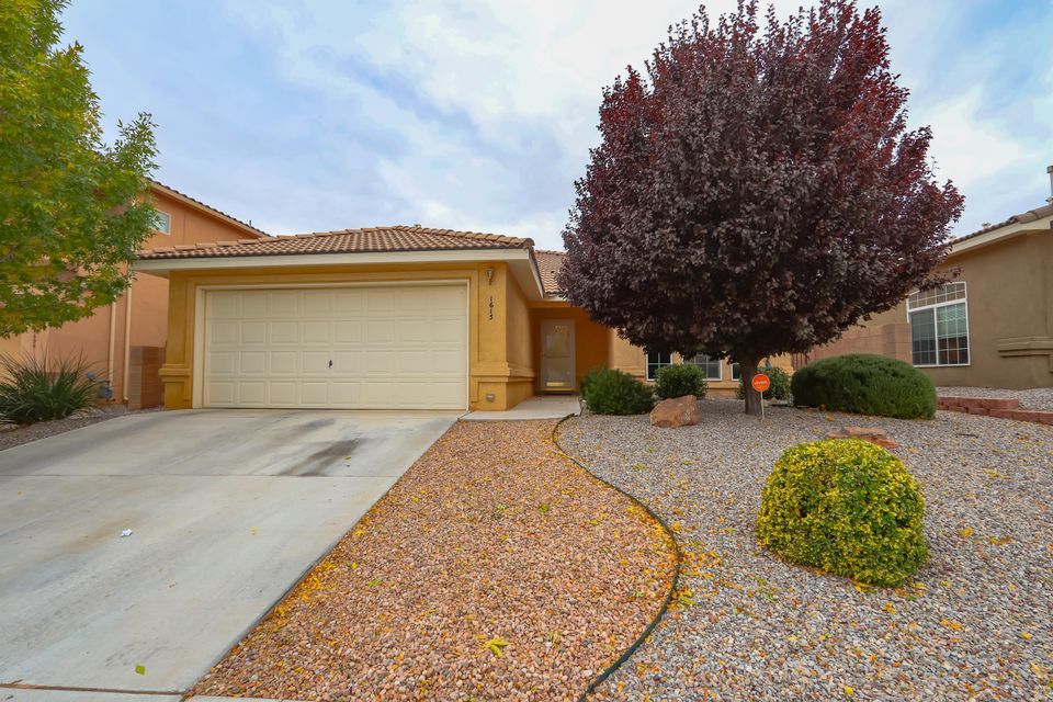 Beautiful Well Maintained Home in the Stormcloud subdivision on Quiet Cul-De-Sac. Move-In Ready, features 3 bedrooms, 2 baths, Large walk-in closet in the master, Refrigerated A/C, Wood Burning Fireplace, Fully Landscaped with Auto Sprinklers. Upgraded w/ shatter proof window treatment. Neighborhood features great amenities, Walking distance to New Tres Volcanes Community Collaborative K-8 School,  2 Parks, one with splash feature for kiddos in the summer, Ample Walking, Jogging, Biking Trails, minutes from the Petroglyph National Monument Trail Head and Unser Blvd pedestrian pathway. Easy commute and access to I-40.