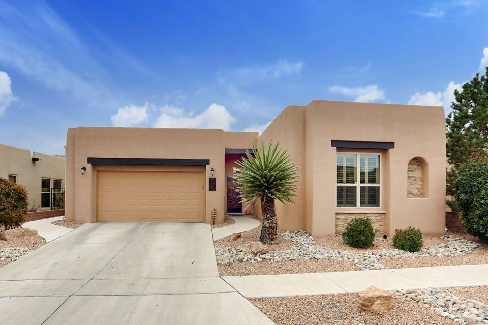 Custom Scott Patrick, Sky View Home built on THE PREMIER VIEW LOT in Andalucia, enjoy Phenomenal CITY & Mountain Views from Foyer,Living Room,Dining Room,Kitchen & Master Suite~Desirable Floor Plan includes Large Kitchen Open to Living Room & Dining Room. Kitchen boasts;Large Breakfast Bar,Granite Island,2 Pantries, Upgraded Appliances~Custom appointments;Hard wood floors,Hunter Douglas Treatments,Water Softener,Surround Sound Prewire,Extended Flagstone Patio,Outdoor Kiva FP with Bancos, Extended Tile in Foyer,Stacked Stone Fireplace and accent wall in LR.  Heating and Air Conditioning only a few years old.